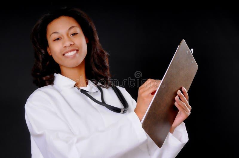 Doutor ou enfermeira do americano africano imagem de stock