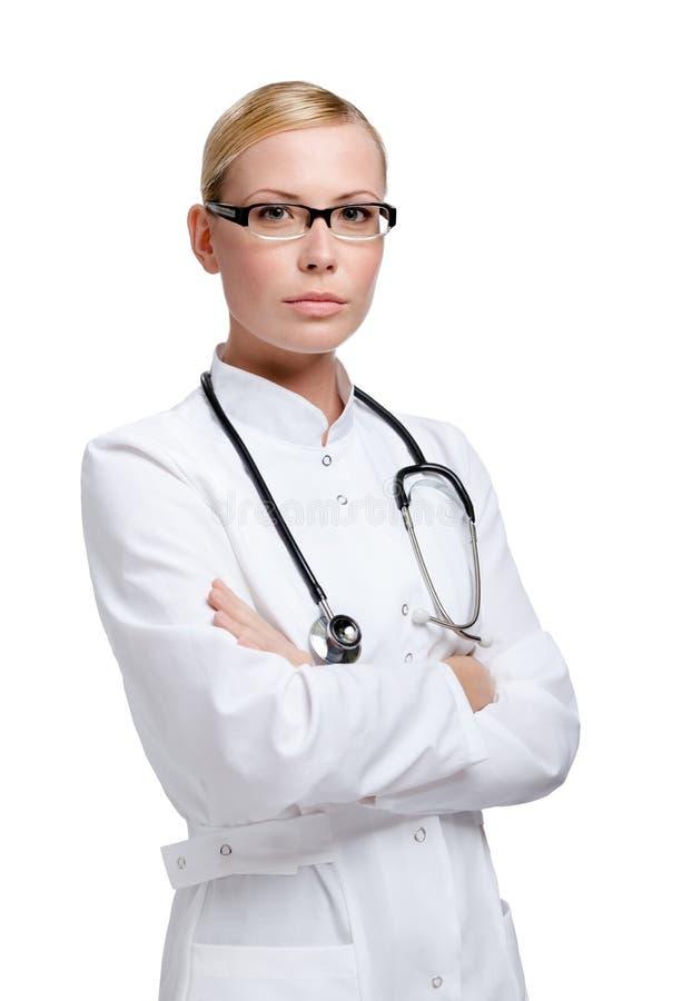 Doutor sério da senhora com estetoscópio fotografia de stock