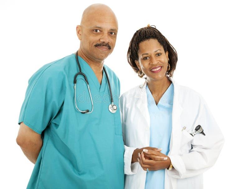 Doutores bem parecidos fotografia de stock