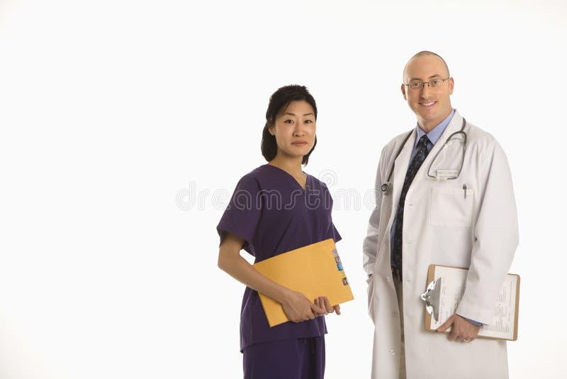 Doutores do homem e da mulher. imagens de stock