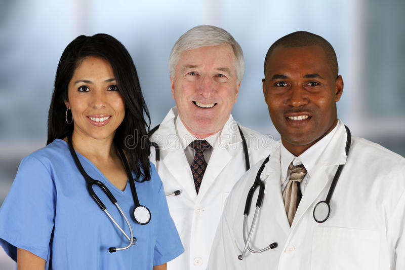 Doutores e enfermeira imagens de stock royalty free