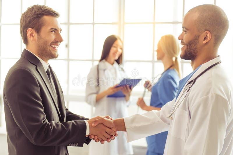 Doutores e homem de negócios imagem de stock royalty free