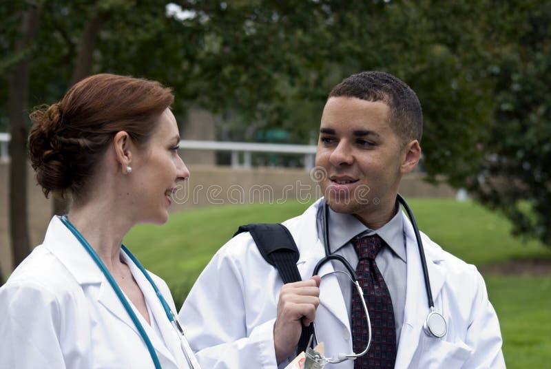 Doutores na ruptura imagens de stock