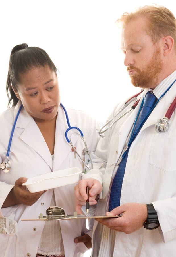 Doutores no trabalho imagem de stock