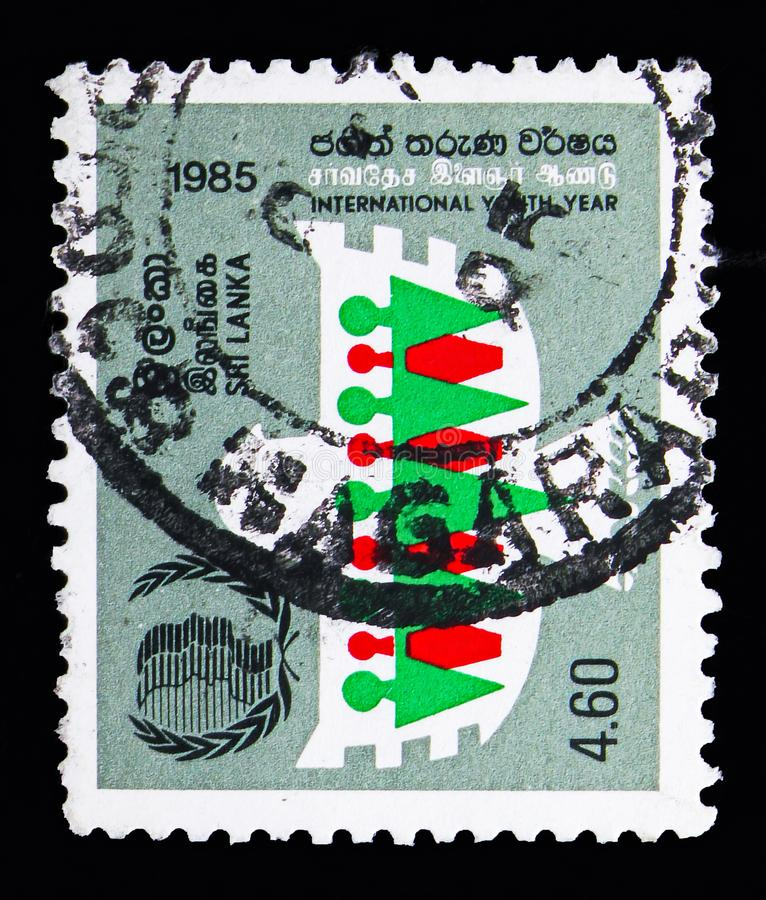 Dove and Stylised Figures, International Youth Year serie, circa. MOSCOW, RUSSIA - MAY 13, 2018: A stamp printed in Sri Lanka shows Dove and Stylised Figures royalty free stock images