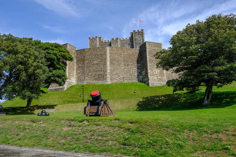 Dover Castle, Dover, Kent, UK - August 17, 2017: Keep walls wit. H green banks and cannon. Bright blue sky day royalty free stock photography
