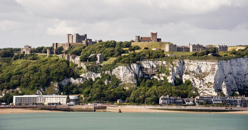 Dover Castle and white cliffs stock photography