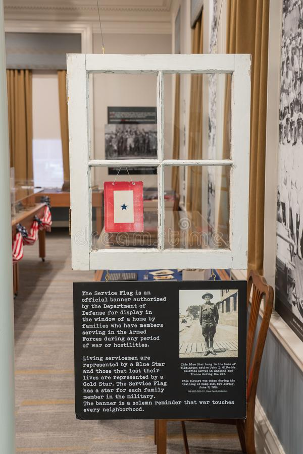 WWI display at the Delaware Public Archives. Dover, DE - April 5, 2019: This WWI display at the Delaware Public Archives describes The Service Flag that would royalty free stock photography