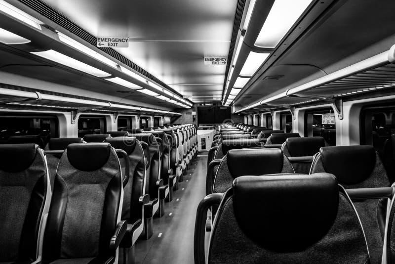 Dover, NJ USA - November 1, 2017: NJ Transit train at night with empty seats, black and white stock photography