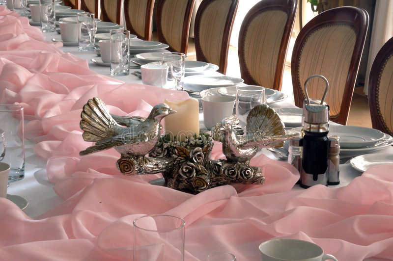 Doves figure on table. Doves figure on pink banquet table stock photo