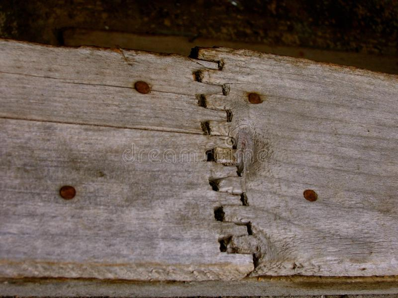 Dovetailed wood panel with rusty nails in ghost town of Ironton in Colorado. Beautiful section of weathered gray wood in the abandoned ruins of the ghost town stock images