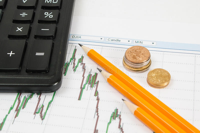 Dow Jones Business chart with calculator, coins and pencil indicates the maximum stock photos