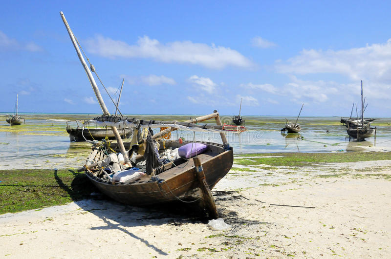 Dow sits at Nungwi. A dow sits at Nungwi, Zanzibar waiting for High Tide. Tanzania. Nungwi is traditionally the centre of Zanzibar's dhow-building industry royalty free stock photography