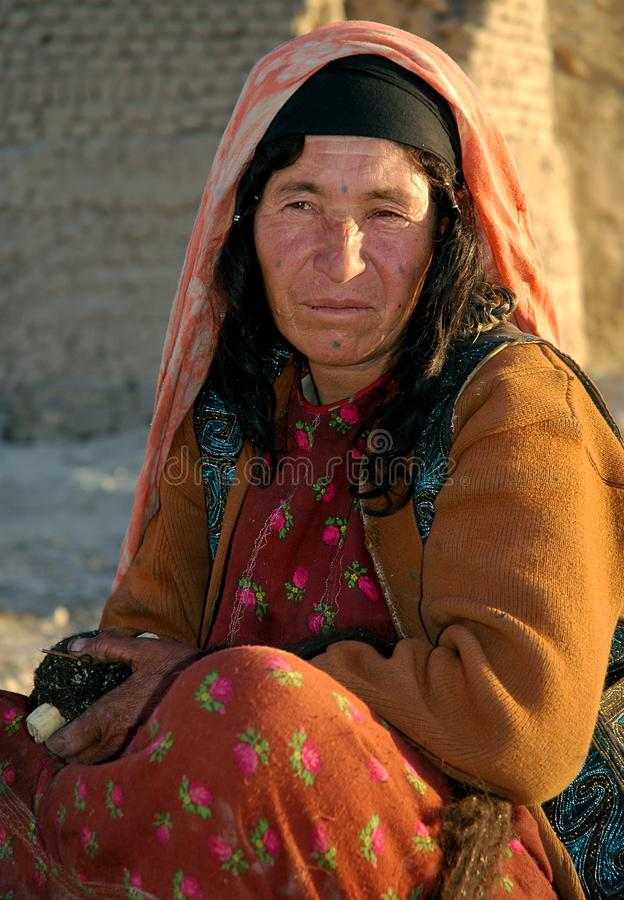 Portrait of an Afghan woman with traditional facial tattoos in Dowlatyar, Ghor Province, Afghanistan. Dowlat Yar, Ghor Province in Afghanistan. Portrait of an royalty free stock image