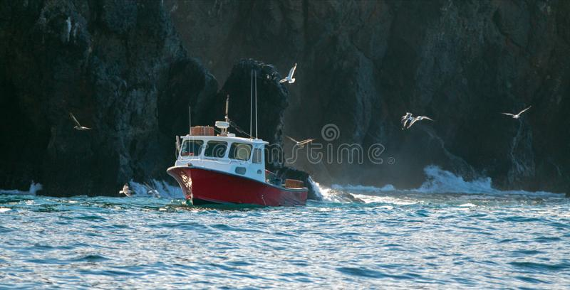 Down east style lobster boat at Coche Point off the coast of Santa Cruz Island in the Channel Islands off the California coast USA royalty free stock photos
