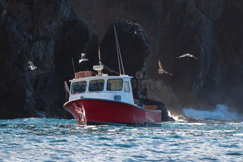 Down east style lobster boat at Coche Point off the coast of Santa Cruz Island in the Channel Islands off the California coast USA stock images
