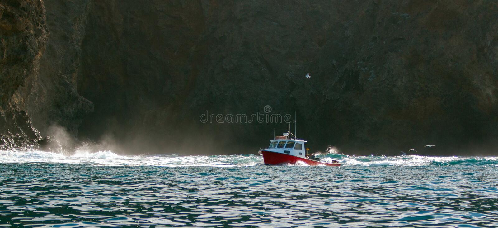 Down east style lobster boat at Coche Point off the coast of Santa Cruz Island in the Channel Islands off the California coast USA royalty free stock image