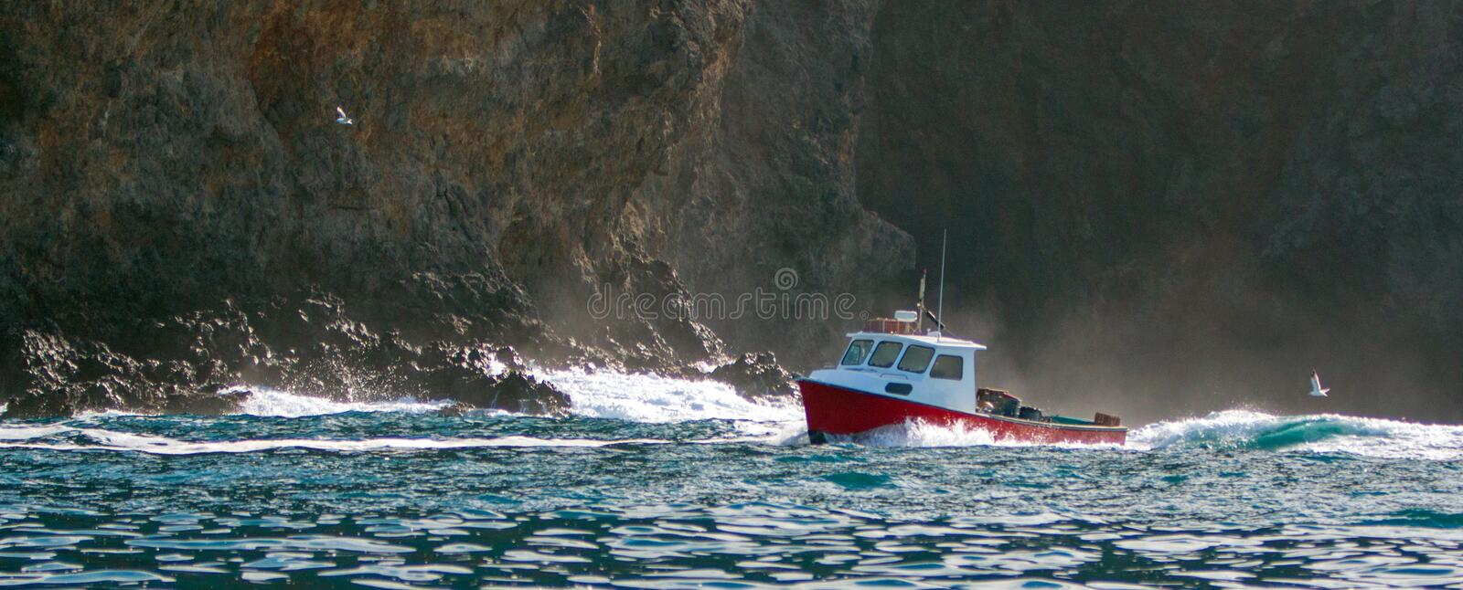 Down east style lobster boat at Coche Point off the coast of Santa Cruz Island in the Channel Islands off the California coast USA royalty free stock images