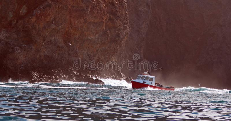Down east style lobster boat at Coche Point off the coast of Santa Cruz Island in the Channel Islands off the California coast USA stock photos