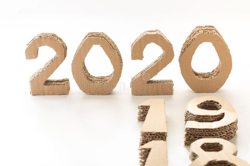 2020 with 19 and 18 down, handmade 3D numbers made of reused cardboard paper, on white background. New year concept. 2020 with 19 and 18 down, handmade 3D royalty free stock photos