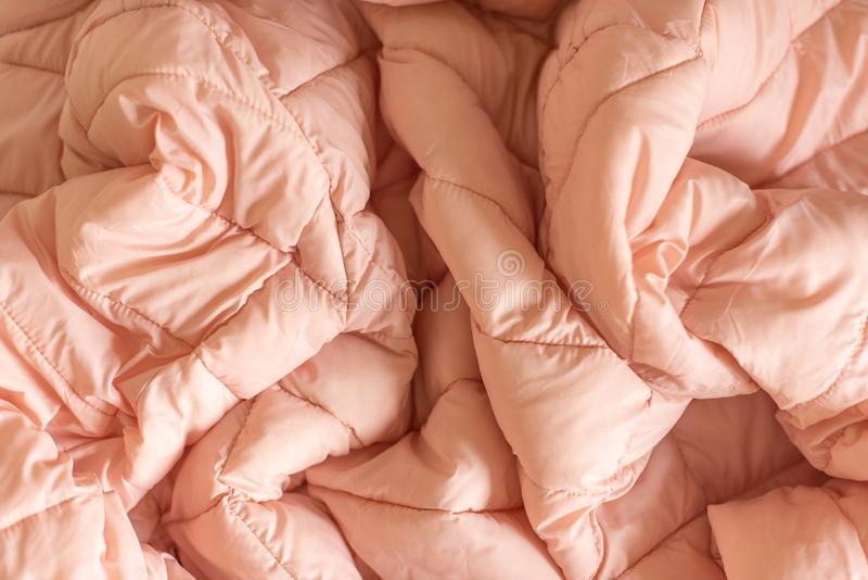 Down jacket fabric background, pink puffer jacket texture royalty free stock photography