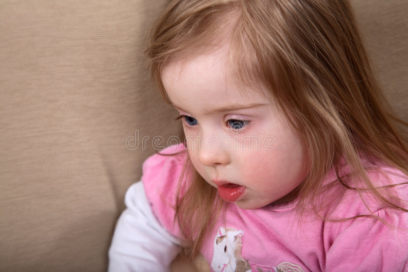 Down syndrome girl royalty free stock images