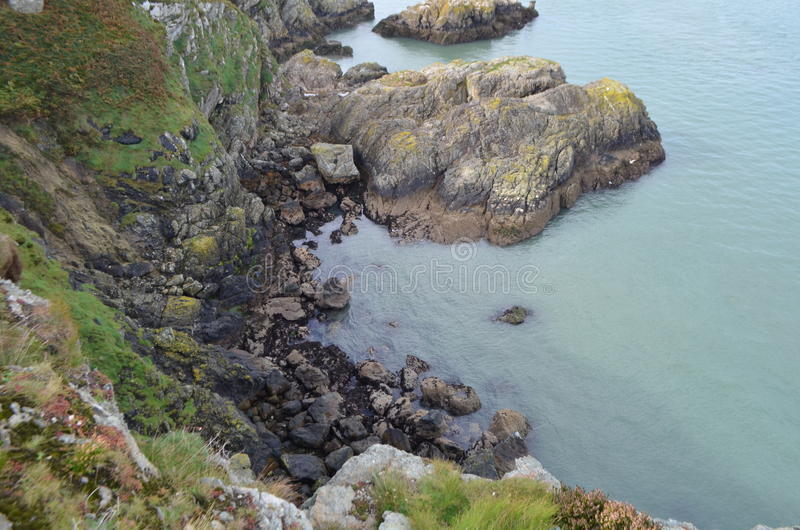 Down View to the Sea of Rocky Mountain Cliff from Ben of Howth, Ireland royalty free stock photo