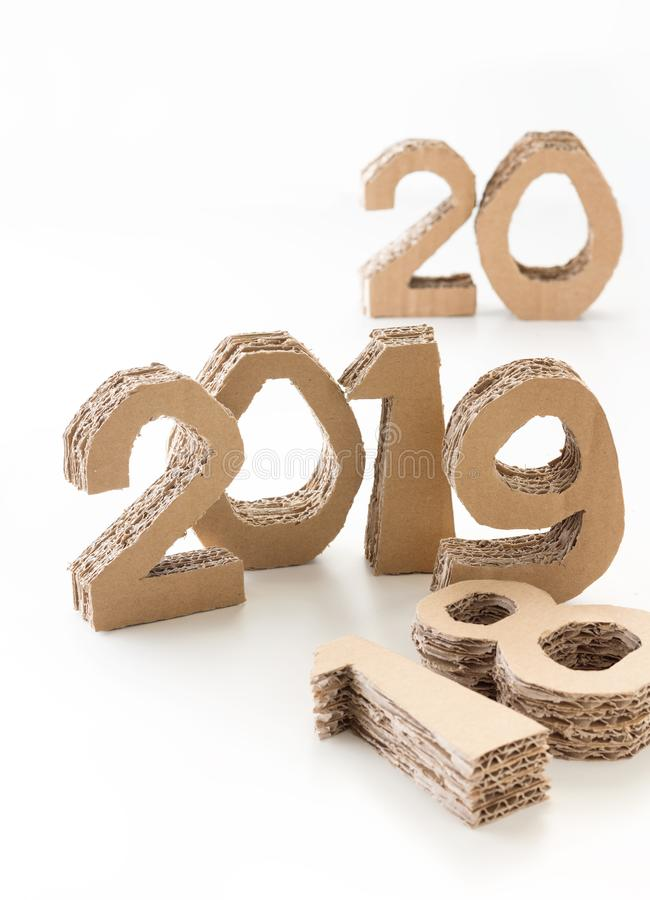 2019 with 18 down and 20 waiting handmade 3D numbers made of reused cardboard paper, on white background. New year concept. 2019 with 18 down and 20 waiting royalty free stock photography