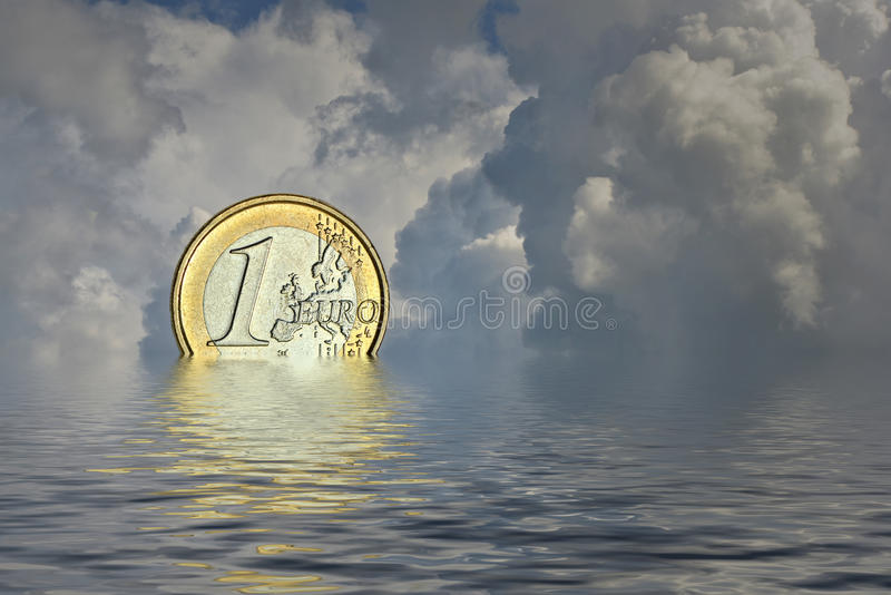Downfall of euro. Sunset with dramatic clouds and the euro water stock images