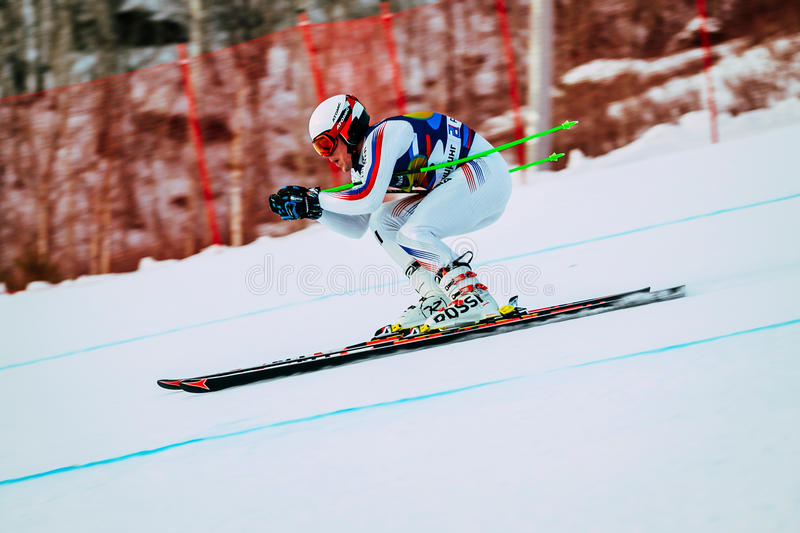 Downhill racer young men in competition Russian Cup in alpine skiing stock photo