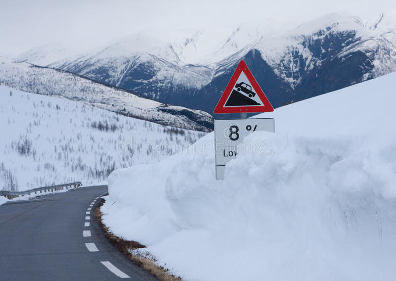 Downhill sign. In snow stock photos