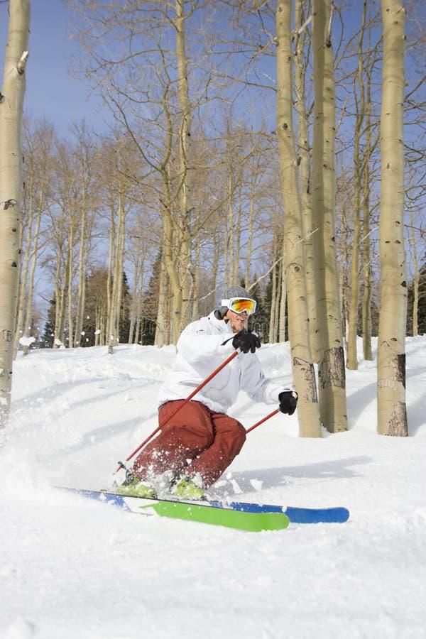 Downhill Skier Making Turn Stock Photo