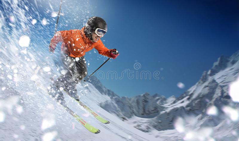 Downhill skier on slopes royalty free stock image