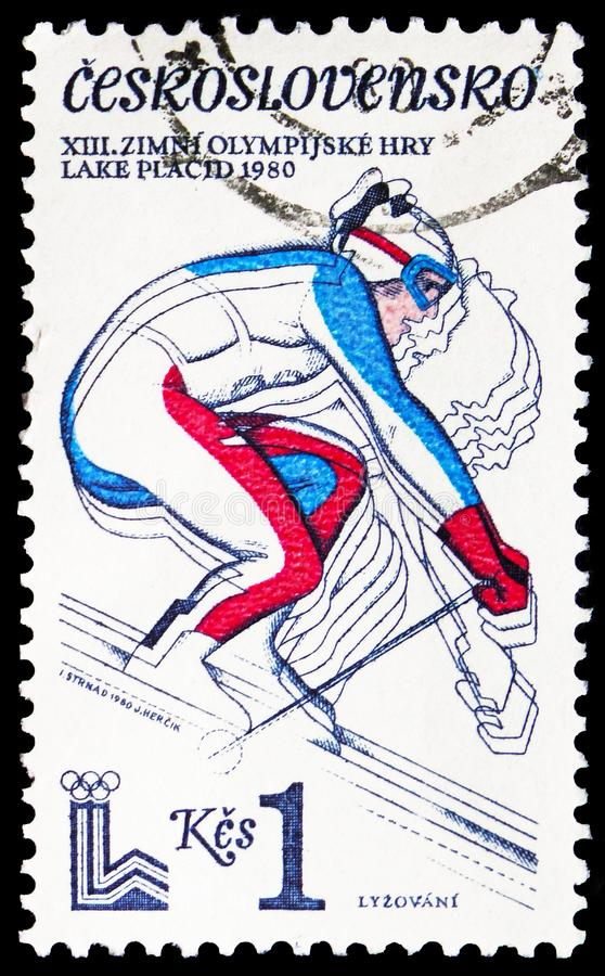 Downhill skiing, Olympic Games 1980 - Lake Placid serie, circa 1980. MOSCOW, RUSSIA - FEBRUARY 21, 2019: A stamp printed in Czechoslovakia shows Downhill skiing stock images