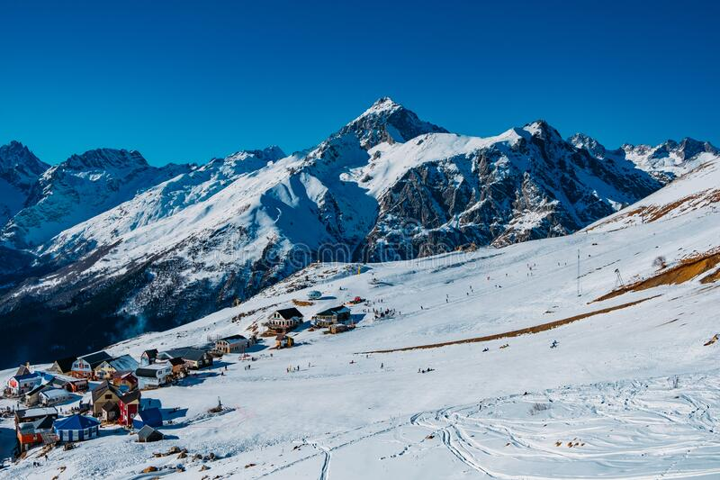 Downhill skiing resort in high mountains. Ski slope.  royalty free stock image