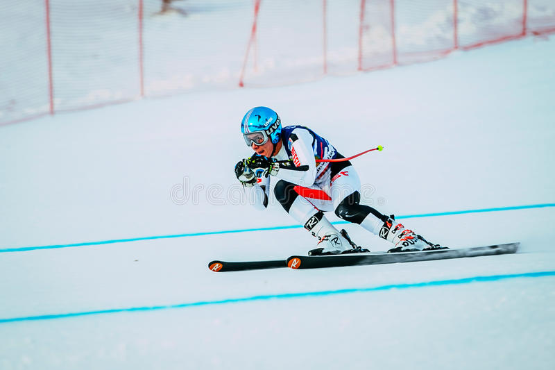Downhill young man athlete skiing to competition Russian Cup in alpine skiing royalty free stock photo