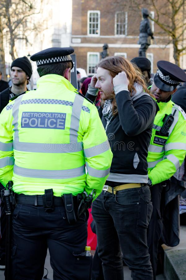 Protesters gather outside Downing Street, London, United Kingdom. Downing Street, London, United Kingdom, 07th March 2018:- Police search an unknown protester stock images