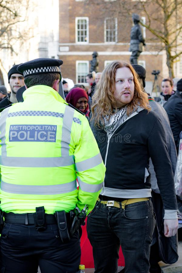 Protesters gather outside Downing Street, London, United Kingdom. Downing Street, London, United Kingdom, 07th March 2018:- Police search an unknown protester stock photography