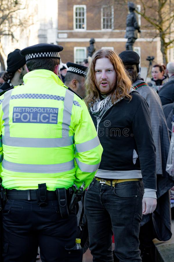 Protesters gather outside Downing Street, London, United Kingdom. Downing Street, London, United Kingdom, 07th March 2018:- Police search an unknown protester royalty free stock photography