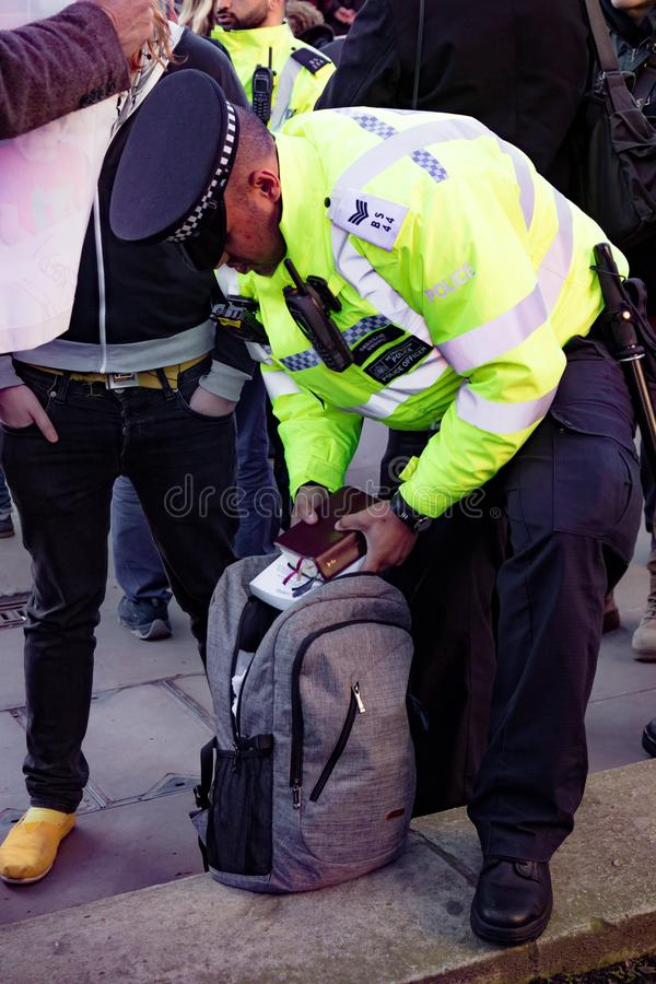 Protesters gather outside Downing Street, London, United Kingdom. Downing Street, London, United Kingdom, 07th March 2018:- Police search an unknown protester stock image