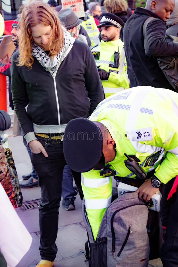 Protesters gather outside Downing Street, London, United Kingdom. Downing Street, London, United Kingdom, 07th March 2018:- Police search an unknown protester royalty free stock image