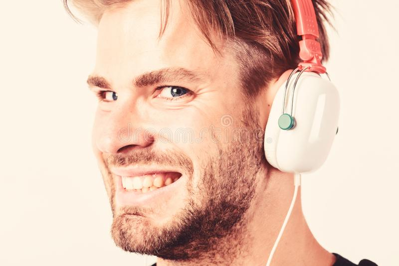 Download music application. Youth music taste. Student handsome guy listening music. Modern people concept. Man tousled. Hairstyle wear plastic earphones gadget stock image