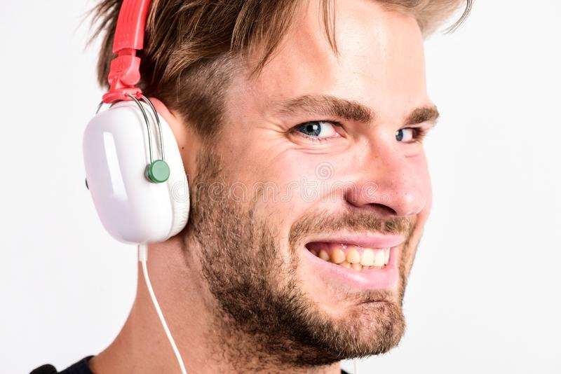 Download music application. Youth music taste. Student handsome guy listening music. Modern people concept. Man tousled. Hairstyle wear plastic earphones gadget stock photo