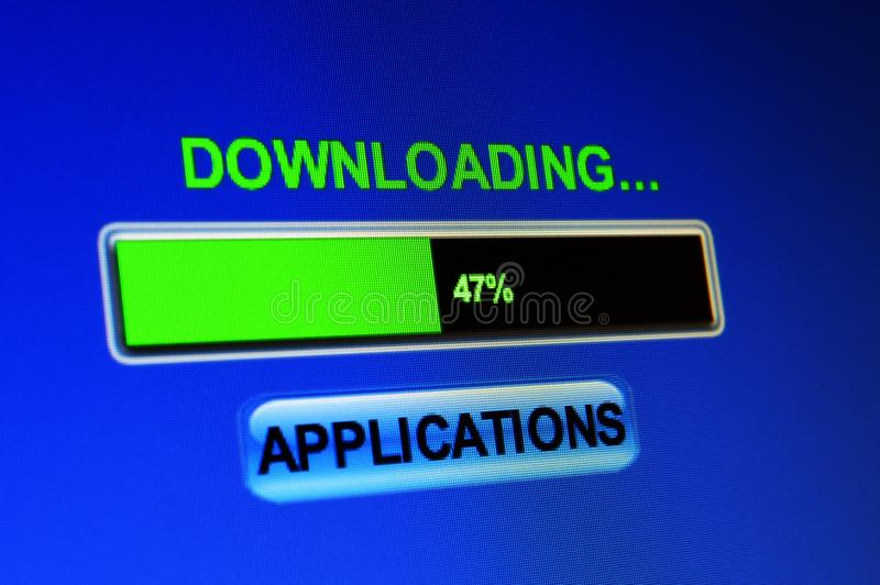Downloading applications. Close up of Downloading applications royalty free stock photos