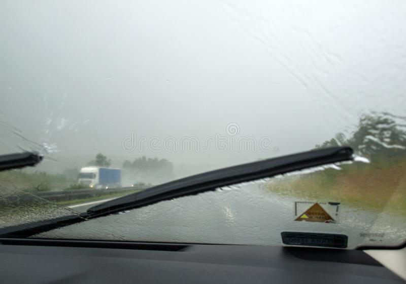 Downpour on the highway seen from inside the car. Downpour on the highway seen from inside the car royalty free stock photo