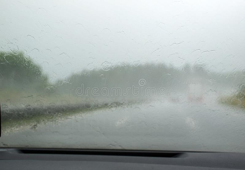 Downpour on the highway seen from inside the car. Downpour on the highway seen from inside the car royalty free stock photography