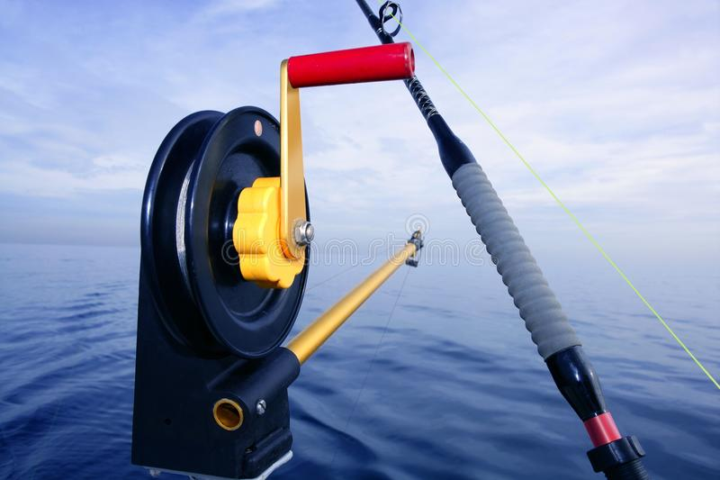 Downrigger angler fishing tackle in blue sea royalty free stock photo