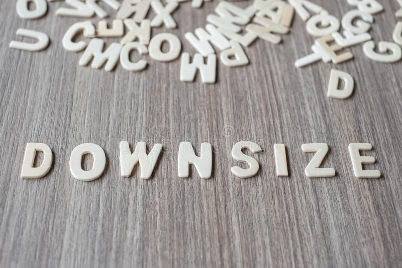 DOWNSIZE word of wooden alphabet letters. Business and Idea. Concept royalty free stock photography