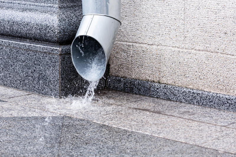 Downspout in heavy rain stock image