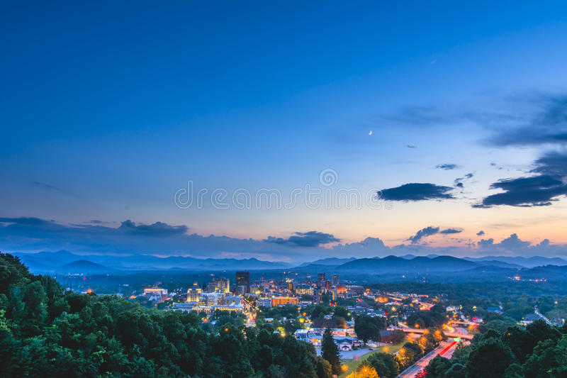 Downtown Asheville, North Carolina Skyline. Sunset over downtown Asheville, North Carolina, a bustling mountain community famous for nature activities and royalty free stock photos